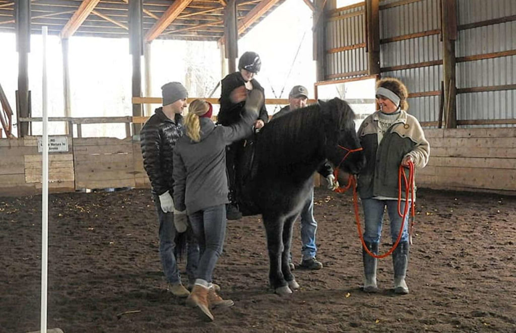 Members of the Horses Touching Hearts Therapeutic Riding Association